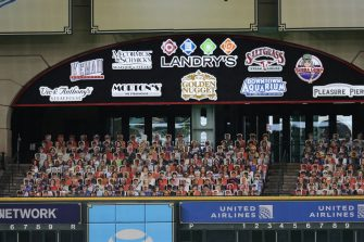 HOUSTON, TEXAS - JULY 24: Cutout pictures of fans are displayed in the Crawford Boxes before Opening Day game between Seattle Mariners and Houston Astros at Minute Maid Park on July 24, 2020 in Houston, Texas. The 2020 season had been postponed since March due to the COVID-19 pandemic. (Photo by Bob Levey/Getty Images)