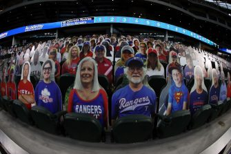 ARLINGTON, TEXAS - JULY 24:  Cardboard cut-out images of fans are seen in the stands before a game between the Colorado Rockies and the Texas Rangers on Opening Day at Globe Life Field on July 24, 2020 in Arlington, Texas.  The 2020 season had been postponed since March due to the COVID-19 pandemic. (Photo by Ronald Martinez/Getty Images)