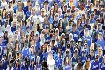 LOS ANGELES, CALIFORNIA - JULY 23: Cardboard cutouts of Los Angeles Dodgers fans are seen in seats before the Opening Day game between the San Francisco Giants and the Los Angeles Dodgers at Dodger Stadium on July 23, 2020 in Los Angeles, California. The 2020 season had been postponed since March due to the COVID-19 pandemic. (Photo by Harry How/Getty Images)
