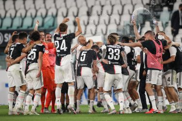 TURIN, ITALY - JULY 26: Juventus players celebrate after the final whistle as they are confirmed as Champions for the ninth season in succession following the 2-0 victory in during the Serie A match between Juventus and  UC Sampdoria at Allianz Stadium on July 26, 2020 in Turin, Italy. (Photo by Jonathan Moscrop/Getty Images)