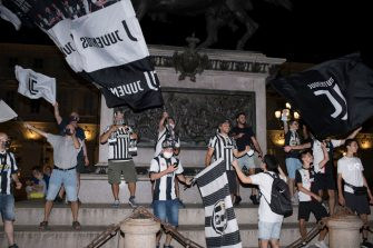 TURIN, ITALY - JULY 26: Juventus FC fans celebrate the team's Serie A victory over UC Sampdoria on July 26, 2020 in Turin, Italy. Fans gathered to celebrate the team's ninth consecutive Scudetto. (Photo by Stefano Guidi/Getty Images)