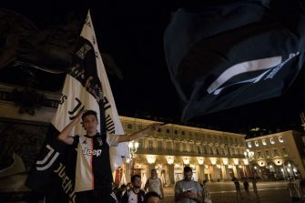 TURIN, ITALY - JULY 26: Juventus FC fans celebrate the victory of the Serie A title on July 26, 2020 in Turin, Italy. Fans gathered to celebrate the team's ninth consecutive Scudetto. (Photo by Stefano Guidi/Getty Images)