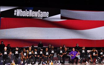 Orlando, FL - JULY 30: The Los Angeles Lakers and the LA Clippers kneel during the National Anthem prior to a game on July 30, 2020 at The Arena at ESPN Wide World Of Sports Complex in Orlando, Florida. NOTE TO USER: User expressly acknowledges and agrees that, by downloading and/or using this Photograph, user is consenting to the terms and conditions of the Getty Images License Agreement. Mandatory Copyright Notice: Copyright 2020 NBAE (Photo by Jesse D. Garrabrant/NBAE via Getty Images)