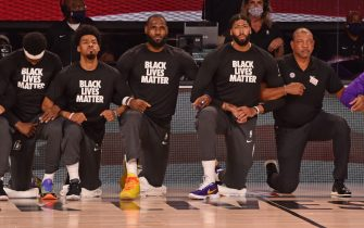ORLANDO, FL - JULY 30: Quinn Cook #28, LeBron James #23 and Anthony Davis #3 of the Los Angeles Lakers kneel for the National Anthem with Doc Rivers of the LA Clippers on July 30, 2020 in Orlando, Florida at The Arena at ESPN Wide World of Sports. NOTE TO USER: User expressly acknowledges and agrees that, by downloading and/or using this photograph, user is consenting to the terms and conditions of the Getty Images License Agreement.  Mandatory Copyright Notice: Copyright 2020 NBAE (Photo by David Dow/NBAE via Getty Images)