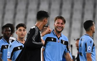 Juventus' Portuguese forward Cristiano Ronaldo (C) congratulates Lazio's Italian forward Ciro Immobile (R) at the end of the Italian Serie A football match between Juventus and Lazio, on July 20, 2020 at the Allianz stadium, in Turin, northern Italy. (Photo by Marco BERTORELLO / AFP) (Photo by MARCO BERTORELLO/AFP via Getty Images)
