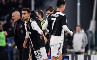 Juventus' Portuguese forward Cristiano Ronaldo (R) leaves the pitch after being substituted by Juventus' Argentine forward Paulo Dybala (L) during the Italian Serie A football match Juventus vs AC Milan on November 10, 2019 at the Juventus Allianz stadium in Turin. (Photo by Marco Bertorello / AFP) (Photo by MARCO BERTORELLO/AFP via Getty Images)