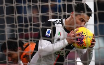 Juventus' Portuguese forward Cristiano Ronaldo kisses the ball as he celebrates after scoring a goal during the Italian Serie A football match Juventus vs Sassuolo on December 1, 2019, at the Juventus Allianz stadium in Turin. (Photo by MARCO BERTORELLO / AFP) (Photo by MARCO BERTORELLO/AFP via Getty Images)