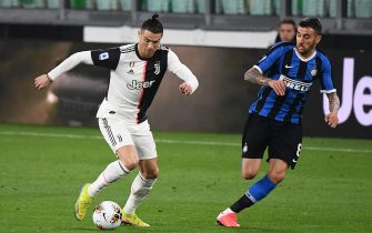 Juventus' Portuguese forward Cristiano Ronaldo (L) vies with Inter Milan's Uruguayan midfielder Matias Vecino during the Italian Serie A football match Juventus vs Inter Milan, at the Juventus stadium in Turin on March 8, 2020. - The match is played behind closed doors due to the novel coronavirus outbreak. (Photo by Vincenzo PINTO / AFP) (Photo by VINCENZO PINTO/AFP via Getty Images)