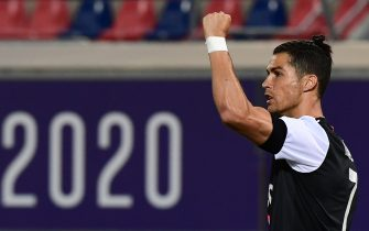 Juventus' Portuguese forward Cristiano Ronaldo celebrates after shooting a penalty kick to open the scoring during the Italian Serie A football match Bologna vs Juventus on June 22, 2020 at the Renato-Dall'Ara stadium in Bologna, as the country eases its lockdown aimed at curbing the spread of the COVID-19 infection, caused by the novel coronavirus. (Photo by Miguel MEDINA / AFP) (Photo by MIGUEL MEDINA/AFP via Getty Images)