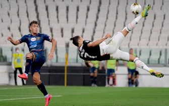 TURIN, ITALY - JUNE 26: (L-R) Nehuen Paz of Lecce, Cristiano Ronaldo of Juventus  during the Italian Serie A   match between Juventus v Lecce at the Allianz Stadium on June 26, 2020 in Turin Italy (Photo by Mattia Ozbot/Soccrates/Getty Images)