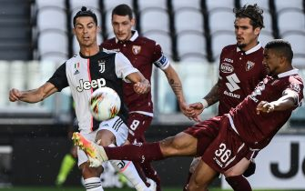 Juventus' Portuguese forward Cristiano Ronaldo (L) and Torino's Brazilian defender Bremer (R) go for the ball during the Italian Serie A football match Juventus vs Torino played behind closed doors on July 4, 2020 at the Juventus stadium in Turin, as the country eases its lockdown aimed at curbing the spread of the COVID-19 infection, caused by the novel coronavirus. (Photo by Marco BERTORELLO / AFP) (Photo by MARCO BERTORELLO/AFP via Getty Images)