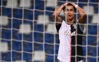 Juventus' Portuguese forward Cristiano Ronaldo reacts after missing a goal opportunity during the Italian Serie A football match between Sassuolo and Juventus Turin played behind closed doors on July 15, 2020 at the Mapei stadium in Reggio Emilia. (Photo by MARCO BERTORELLO / AFP) (Photo by MARCO BERTORELLO/AFP via Getty Images)