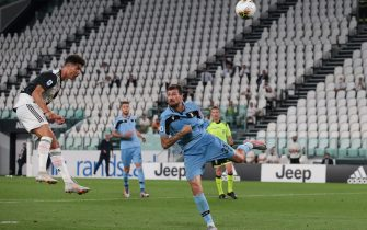TURIN, ITALY - JULY 20: Portuguese striker Cristiano Ronaldo of Juventus heads the ball towards the SS Lazio goal during the Serie A match between Juventus and SS Lazio at Allianz Stadium on July 20, 2020 in Turin, Italy. (Photo by Jonathan Moscrop/Getty Images)