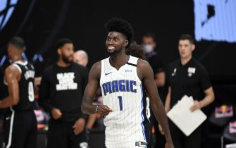 Orlando, FL - JULY 31: Jonathan Isaac #1 of the Orlando Magic smiles during the game against the Brooklyn Nets on July 31, 2020 at The HP Field House at ESPN Wide World Of Sports Complex in Orlando, Florida. NOTE TO USER: User expressly acknowledges and agrees that, by downloading and/or using this Photograph, user is consenting to the terms and conditions of the Getty Images License Agreement. Mandatory Copyright Notice: Copyright 2020 NBAE (Photo by Garrett Ellwood/NBAE via Getty Images)