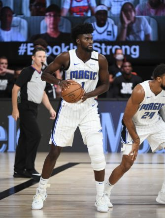 Orlando, FL - JULY 31: Jonathan Isaac #1 of the Orlando Magic handles the ball during the game against the Brooklyn Nets on July 31, 2020 at The HP Field House at ESPN Wide World Of Sports Complex in Orlando, Florida. NOTE TO USER: User expressly acknowledges and agrees that, by downloading and/or using this Photograph, user is consenting to the terms and conditions of the Getty Images License Agreement. Mandatory Copyright Notice: Copyright 2020 NBAE (Photo by Garrett Ellwood/NBAE via Getty Images)