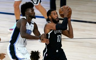 LAKE BUENA VISTA, FL - JULY 31: Garrett Temple #17 of the Brooklyn Nets heads to the basket past Jonathan Isaac #1 during the first half on July 31, 2020 at The HP Field House at ESPN Wide World Of Sports Complex in Lake Buena Vista, Florida. NOTE TO USER: User expressly acknowledges and agrees that, by downloading and/or using this Photograph, user is consenting to the terms and conditions of the Getty Images License Agreement. (Photo by Ashley Landis - Pool/Getty Images)