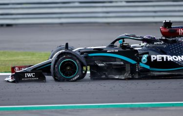 Mercedes' British driver Lewis Hamilton punctures near the finish of the Formula One British Grand Prix at the Silverstone motor racing circuit in Silverstone, central England on August 2, 2020. - Lewis Hamilton wins record seventh British Grand Prix . (Photo by ANDREW BOYERS / POOL / AFP) (Photo by ANDREW BOYERS/POOL/AFP via Getty Images)
