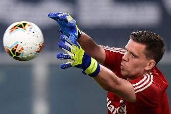 Juventus' Polish goalkeeper Wojciech Szczesny warms up prior to the Italian Serie A football match Genoa vs Juventus played on June 30, 2020 behind closed doors at the Luigi-Ferraris stadium in Genoa, as the country eases its lockdown aimed at curbing the spread of the COVID-19 infection, caused by the novel coronavirus. (Photo by Miguel MEDINA / AFP) (Photo by MIGUEL MEDINA/AFP via Getty Images)