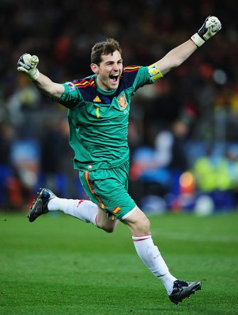 JOHANNESBURG, SOUTH AFRICA - JULY 11:  Iker Casillas, captain of Spain, celebrates the late goal by Andres Iniesta during the 2010 FIFA World Cup South Africa Final match between Netherlands and Spain at Soccer City Stadium on July 11, 2010 in Johannesburg, South Africa.  (Photo by Clive Mason/Getty Images)