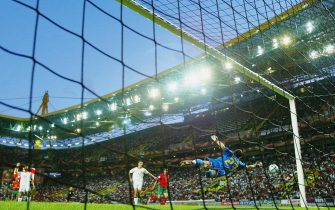 LISBON, PORTUGAL - JUNE 20:  Iker Casillas of Spain makes a save during the UEFA Euro 2004 Group A match between Portugal and Spain on June 20, 2004 at the Estadio Jose Alvalade in Lisbon, Portugal. (Photo by Ben Radford/Getty Images)