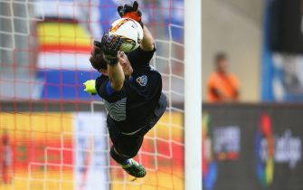 COLOGNE, GERMANY - AUGUST 01:  Iker Casillas of Porto saves the decision penalty of Joao Cancelo of Valencia (not in the pictture) during the Colonia Cup 2015 match between FC Valencia and FC Porto at RheinEnergieStadion on August 1, 2015 in Cologne, Germany. The match between Valencia and Porto ended 4-5 after penalty shoot-out.  (Photo by Christof Koepsel/Getty Images)