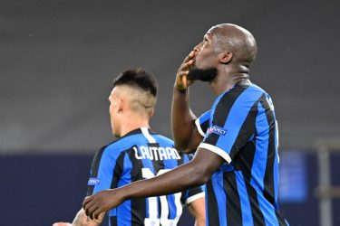 Inter Milan's Belgian forward Romelu Lukaku celebrates scoring the opening goal with his teammates during the UEFA Europa League round of 16 football match Inter Milan v Getafe on August 5, 2020 in Gelsenkirchen, western Germany. (Photo by Ina Fassbender / various sources / AFP) (Photo by INA FASSBENDER/POOL/AFP via Getty Images)