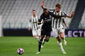 Lyon's French forward Karl Toko Ekambi (L)  fights for the ball with Juventus' Dutch defender Matthijs de Ligt during the UEFA Champions League round of 16 second leg football match between Juventus and Olympique Lyonnais (OL), played behind closed doors due to the spread of the COVID-19 infection, caused by the novel coronavirus, at the Juventus stadium, in Turin , on August 7, 2020. (Photo by Miguel MEDINA / AFP) (Photo by MIGUEL MEDINA/AFP via Getty Images)