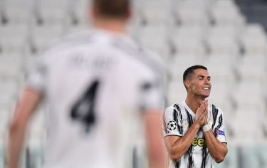 Juventus' Portuguese forward Cristiano Ronaldo reacts during the UEFA Champions League round of 16 second leg football match between Juventus and Olympique Lyonnais (OL), played behind closed doors due to the spread of the COVID-19 infection, caused by the novel coronavirus, at the Juventus stadium, in Turin , on August 7, 2020. (Photo by Miguel MEDINA / AFP) (Photo by MIGUEL MEDINA/AFP via Getty Images)