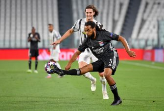TURIN, ITALY - AUGUST 07: Jason Denayer of Olympique Lyon controls the ball under pressure from Adrien Rabiot of Juventus during the UEFA Champions League round of 16 second leg match between Juventus and Olympique Lyon at Allianz Stadium on August 07, 2020 in Turin, Italy. (Photo by Valerio Pennicino/Getty Images)
