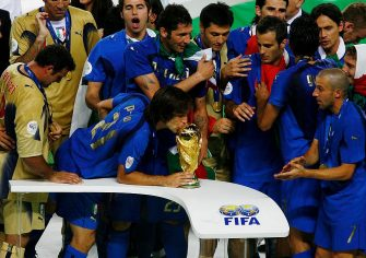 BERLIN - JULY 09:  Andrea Pirlo of Italy kisses the World Cup trophy following his team's victory in a penalty shootout at the end of the FIFA World Cup Germany 2006 Final match between Italy and France at the Olympic Stadium on July 9, 2006 in Berlin, Germany.  (Photo by Clive Mason/Getty Images)