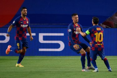 Barcelona's French defender Clement Lenglet (C) celebrates with Barcelona's Argentine forward Lionel Messi (R) and Barcelona's Uruguayan forward Luis Suarez (R) after scoring a goal during the UEFA Champions League round of 16 second leg football match between FC Barcelona and Napoli at the Camp Nou stadium in Barcelona on August 8, 2020. (Photo by LLUIS GENE / AFP) (Photo by LLUIS GENE/AFP via Getty Images)