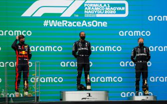 BUDAPEST, HUNGARY - JULY 19: Race winner Lewis Hamilton of Great Britain and Mercedes GP, second placed Max Verstappen of Netherlands and Red Bull Racing and third placed Valtteri Bottas of Finland and Mercedes GP stand on the podium after the Formula One Grand Prix of Hungary at Hungaroring on July 19, 2020 in Budapest, Hungary. (Photo by Leonhard Foeger/Pool via Getty Images)