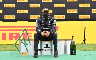 Winner Mercedes' British driver Lewis Hamilton reacts on the podium after winning the Formula One Styrian Grand Prix race on July 12, 2020 in Spielberg, Austria. (Photo by JOE KLAMAR / various sources / AFP) (Photo by JOE KLAMAR/AFP via Getty Images)
