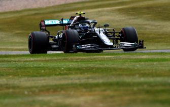 NORTHAMPTON, ENGLAND - AUGUST 08: Valtteri Bottas of Finland driving the (77) Mercedes AMG Petronas F1 Team Mercedes W11 on track during qualifying for the F1 70th Anniversary Grand Prix at Silverstone on August 08, 2020 in Northampton, England. (Photo by Rudy Carezzevoli/Getty Images)