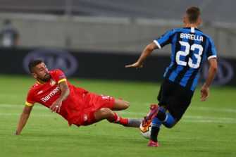 Leverkusen's German midfielder Kerem Demirbay (L) and Inter Milan's Italian midfielder Nicolo Barella vie for the ball during the UEFA Europa League quarter-final football match Inter Milan v Bayer 04 Leverkusen at the Duesseldorf Arena on August 10, 2020 in Duesseldorf, western Germany. (Photo by Dean Mouhtaropoulos / POOL / AFP) (Photo by DEAN MOUHTAROPOULOS/POOL/AFP via Getty Images)