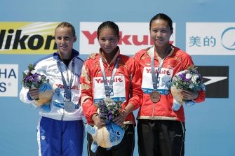 BARCELONA, SPAIN - JULY 23:  (L-R) Silver medallist Tania Cagnotto of Italy, gold medallist He Zi of China and bronze medallist Han Wang of China celebrate after the Women's 1m Springboard Diving final on day four of the 15th FINA World Championships at Piscina Municipal de Montjuic on July 23, 2013 in Barcelona, Spain.  (Photo by Adam Pretty/Getty Images)