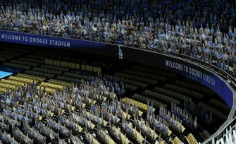 LOS ANGELES, CA - AUGUST 09: Cardboard cutouts of Los Angeles Dodgers fans are seen in seats before the start of the San Francisco Giants and Los Angeles Dodgers at Dodger Stadium on August 9, 2020 in Los Angeles, California. The 2020 regular season has been shortened to 60 games and fans are not allowed in the stadium due to the COVID-19 pandemic. (Photo by Kevork Djansezian/Getty Images)