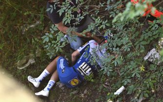 Deceuninck - Quick Step Belgium rider Remco Evenepoel lies down after crashed during the 114th edition of the giro di Lombardia (Tour of Lombardy),  a 231 km cycling race from Bergamo to Como on August 15, 2020. (Photo by Marco BERTORELLO / AFP) (Photo by MARCO BERTORELLO/AFP via Getty Images)