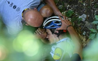 Deceuninck - Quick Step Belgium rider Remco Evenepoel is helped by staff member as he lies down after crashed during the 114th edition of the giro di Lombardia (Tour of Lombardy),  a 231 km cycling race from Bergamo to Como on August 15, 2020. (Photo by Marco BERTORELLO / AFP) (Photo by MARCO BERTORELLO/AFP via Getty Images)