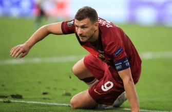 AS Roma's Bosnian forward Edin Dzeko sits on the pitch during the UEFA Europa League round of 16 football match between Sevilla FC and AS Roma at the MSV Arena on August 6, 2020 in Duisburg. (Photo by WOLFGANG RATTAY / POOL / AFP) (Photo by WOLFGANG RATTAY/POOL/AFP via Getty Images)