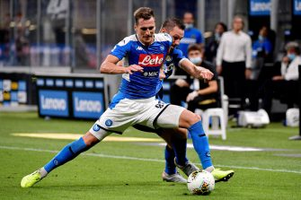 MILAN, ITALY - JULY 28: (L-R) Arkadiusz Milik of Napoli, Stefan de Vrij of Internazionale  during the Italian Serie A   match between Internazionale v Napoli at the San Siro on July 28, 2020 in Milan Italy (Photo by Mattia Ozbot/Soccrates/Getty Images)