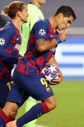 Barcelona's Uruguayan forward Luis Suarez celebrates after scoring a goal during the UEFA Champions League quarter-final football match between Barcelona and Bayern Munich at the Luz stadium in Lisbon on August 14, 2020. (Photo by Rafael Marchante / POOL / AFP) (Photo by RAFAEL MARCHANTE/POOL/AFP via Getty Images)