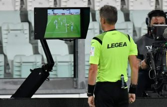 TURIN, ITALY - JULY 20: The referee Daniele Orsato consults VAR after he awards a free kick to Juventus which is later changed to a penalty VAR decision during the Serie A match between Juventus and SS Lazio at Allianz Stadium on July 20, 2020 in Turin, Italy. (Photo by Stefano Guidi/Getty Images)