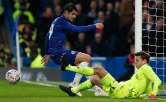 Chelsea's Spanish striker Alvaro Morata (L) misses a chance to score past Nottingham Forest's English goalkeeper Luke Steele (R) during the English FA Cup third round football match between Chelsea and Nottingham Forest at Stamford Bridge in London on January 5, 2019. (Photo by Adrian DENNIS / AFP) / RESTRICTED TO EDITORIAL USE. No use with unauthorized audio, video, data, fixture lists, club/league logos or 'live' services. Online in-match use limited to 120 images. An additional 40 images may be used in extra time. No video emulation. Social media in-match use limited to 120 images. An additional 40 images may be used in extra time. No use in betting publications, games or single club/league/player publications. /         (Photo credit should read ADRIAN DENNIS/AFP via Getty Images)