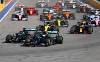 SOCHI, RUSSIA - SEPTEMBER 27: Valtteri Bottas of Finland driving the (77) Mercedes AMG Petronas F1 Team Mercedes W11 leads the field at the first corner during the F1 Grand Prix of Russia at Sochi Autodrom on September 27, 2020 in Sochi, Russia. (Photo by Yuri Kochetkov - Pool/Getty Images)