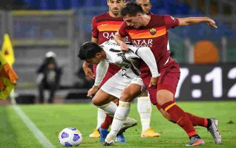 Juventus' Spanish forward Alvaro Morata (L) holds off AS Roma's Albanian defender Marash Kumbulla during the Italian Serie A football match Roma vs Juventus on September 27, 2020 at the Olympic stadium in Rome. (Photo by Tiziana FABI / AFP) (Photo by TIZIANA FABI/AFP via Getty Images)