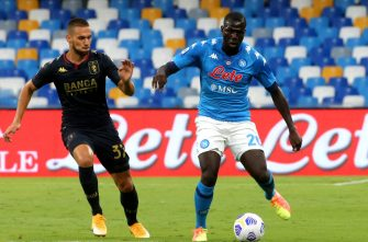 NAPLES, ITALY - SEPTEMBER 27: Kalidou Koulibaly of SSC Napoli competes for the ball with Mario Pjaca of Genoa CFC during the Serie A match between SSC Napoli and Genoa CFC at Stadio San Paolo on September 27, 2020 in Naples, Italy. (Photo by MB Media/Getty Images)