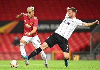 MANCHESTER, ENGLAND - AUGUST 05: Petar Filipovic of LASK tackles Andreas Pereira of Manchester United during the UEFA Europa League round of 16 second leg match between Manchester United and LASK at Old Trafford on August 05, 2020 in Manchester, England. (Photo by Michael Regan/Getty Images)