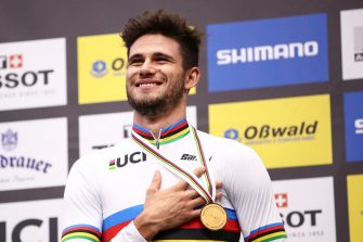 BERLIN, GERMANY - FEBRUARY 28: Gold medalist Filippo Ganna of Italy poses on the podium after the men's individual pursuit final during day 3 of the UCI Track Cycling World Championships Berlin at Velodrom on February 28, 2020 in Berlin, Germany. (Photo by Maja Hitij/Getty Images)