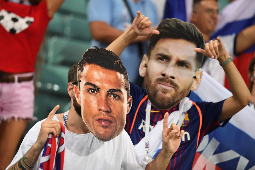 Football fans wearing masks depicting Portugal's forward Cristiano Ronaldo and Argentina's forward Lionel Messi pose before the Russia 2018 World Cup quarter-final football match between Russia and Croatia at the Fisht Stadium in Sochi on July 7, 2018. (Photo by Kirill KUDRYAVTSEV / AFP) / RESTRICTED TO EDITORIAL USE - NO MOBILE PUSH ALERTS/DOWNLOADS        (Photo credit should read KIRILL KUDRYAVTSEV/AFP via Getty Images)